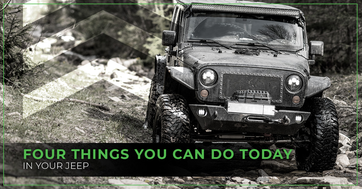 Jeep wrangler driving on rough muddy terrain