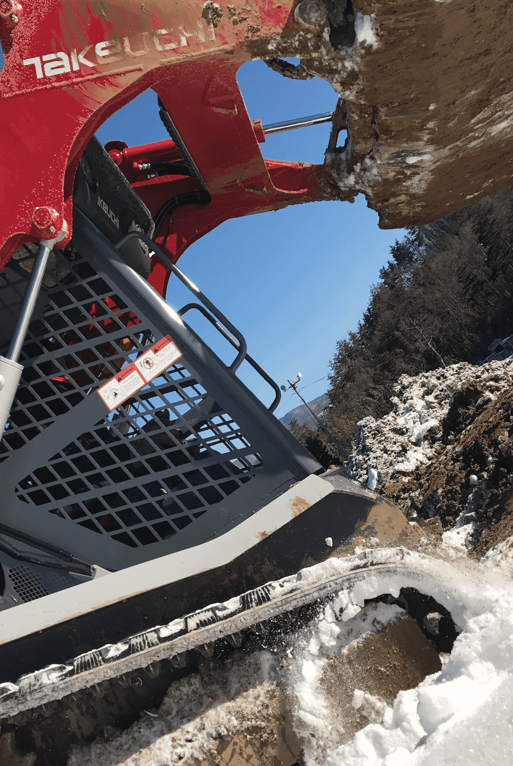 Takeuchi excavator rips through the frozen Earth after Takeuchi parts replacement