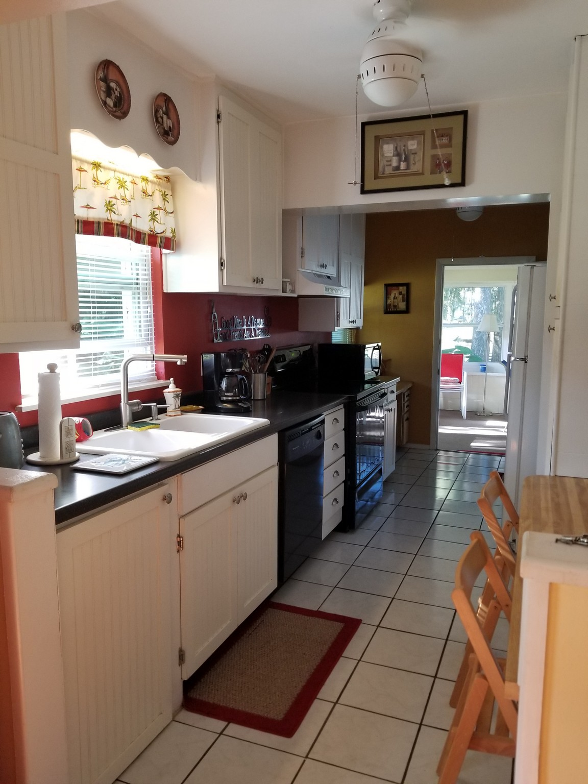 photo of kitchen with dishwasher, stove, and microwave