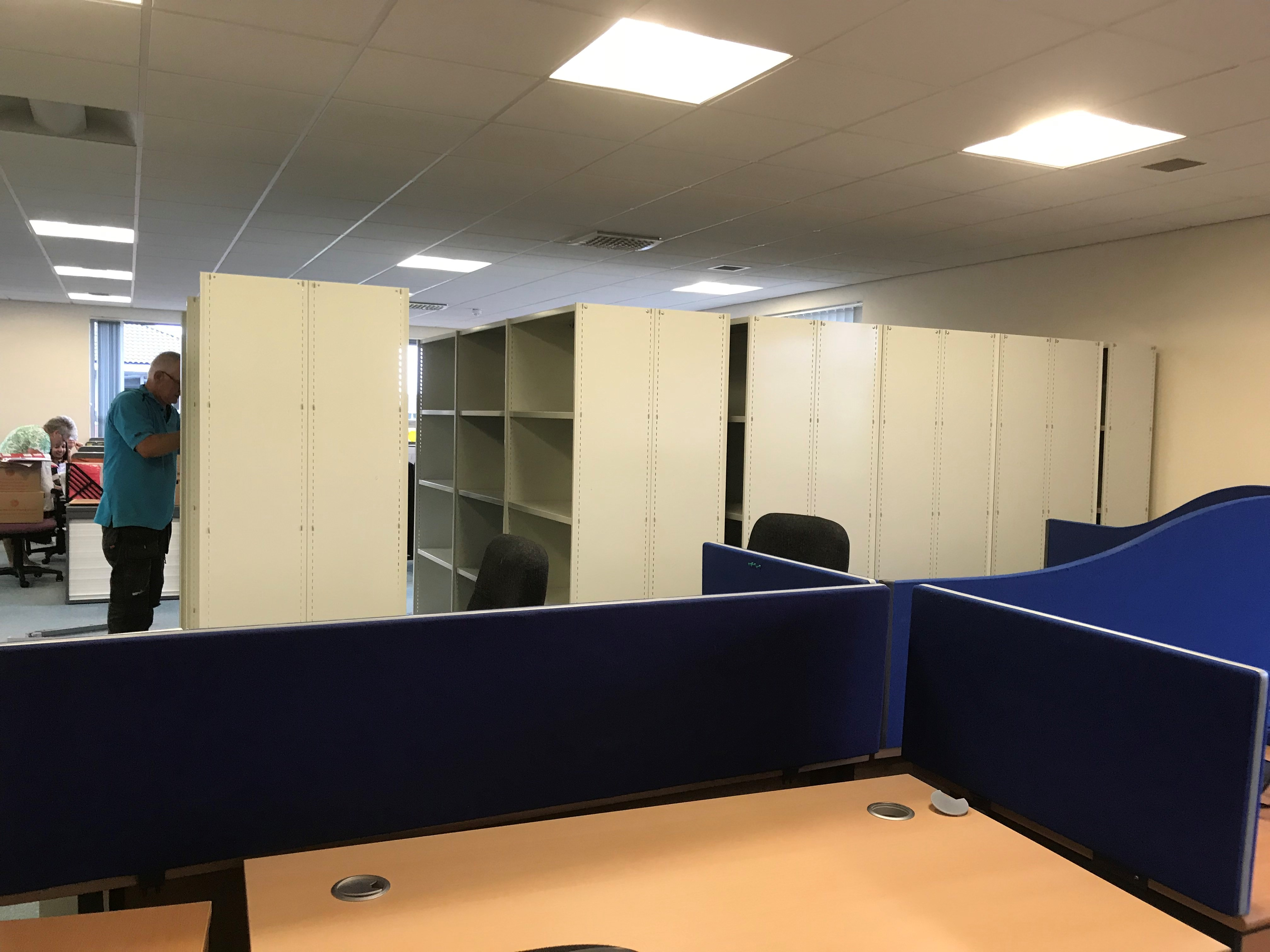 6 large cream filing cabinets full of paper documentation standing in Boolers office that required scanning