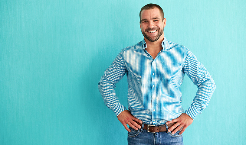Male business professional wearing a blue shirt and jeans