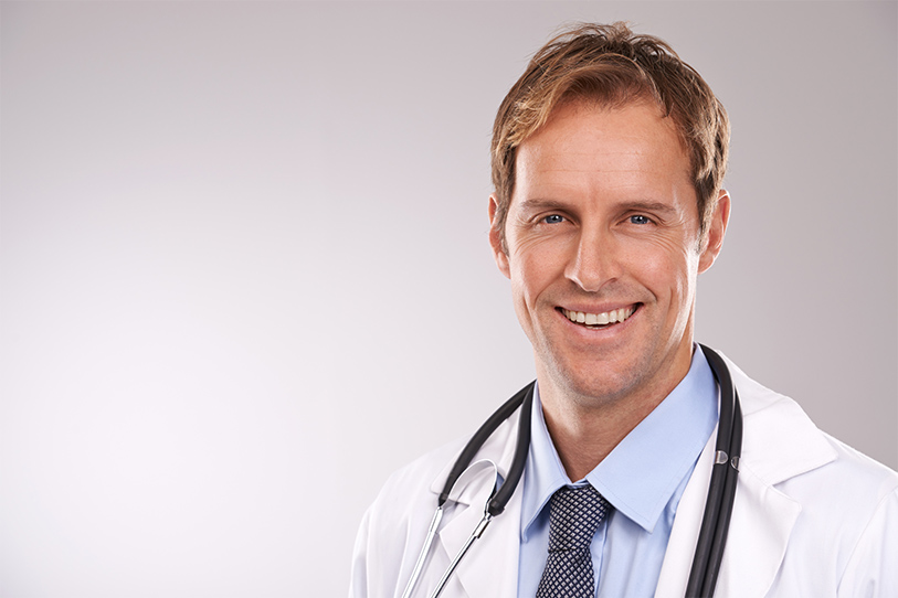 Male doctor wearing white coat with stethoscope
