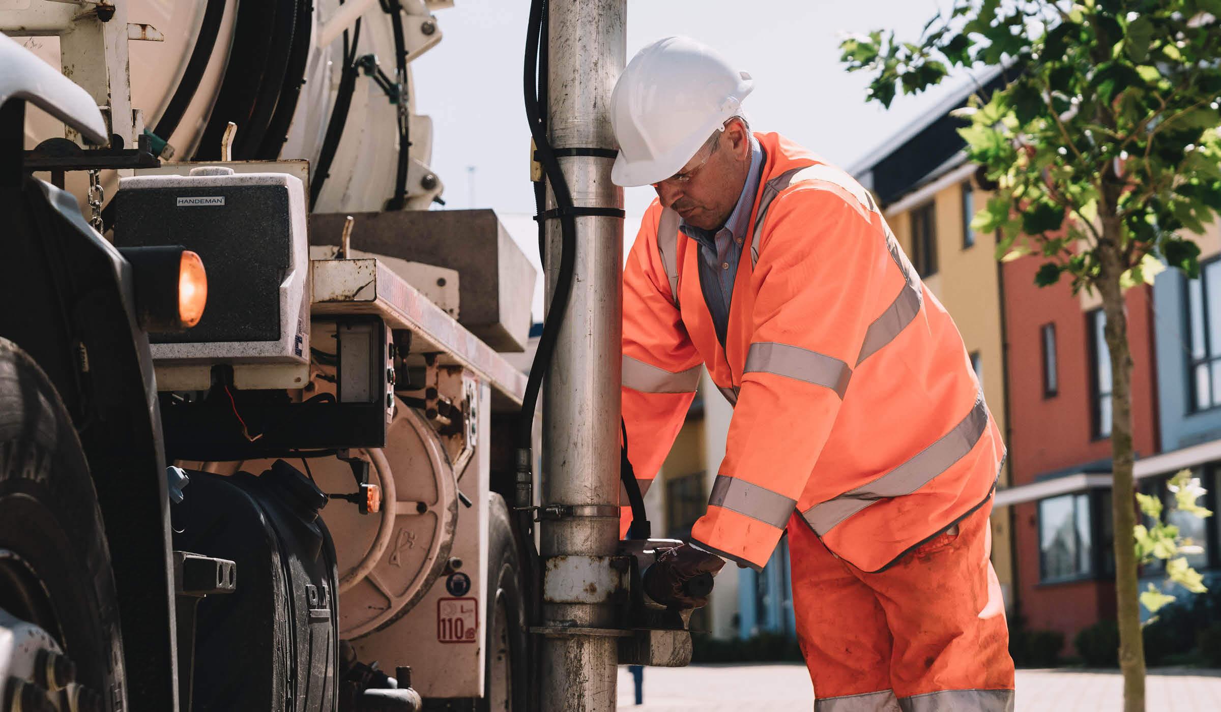 photograph of Bristol based environmental services vehicle sucking up sewage
