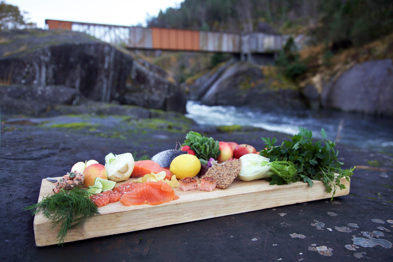 Food in front of a river and bridge