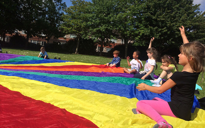 Parachute games at Bristol primary school sports club