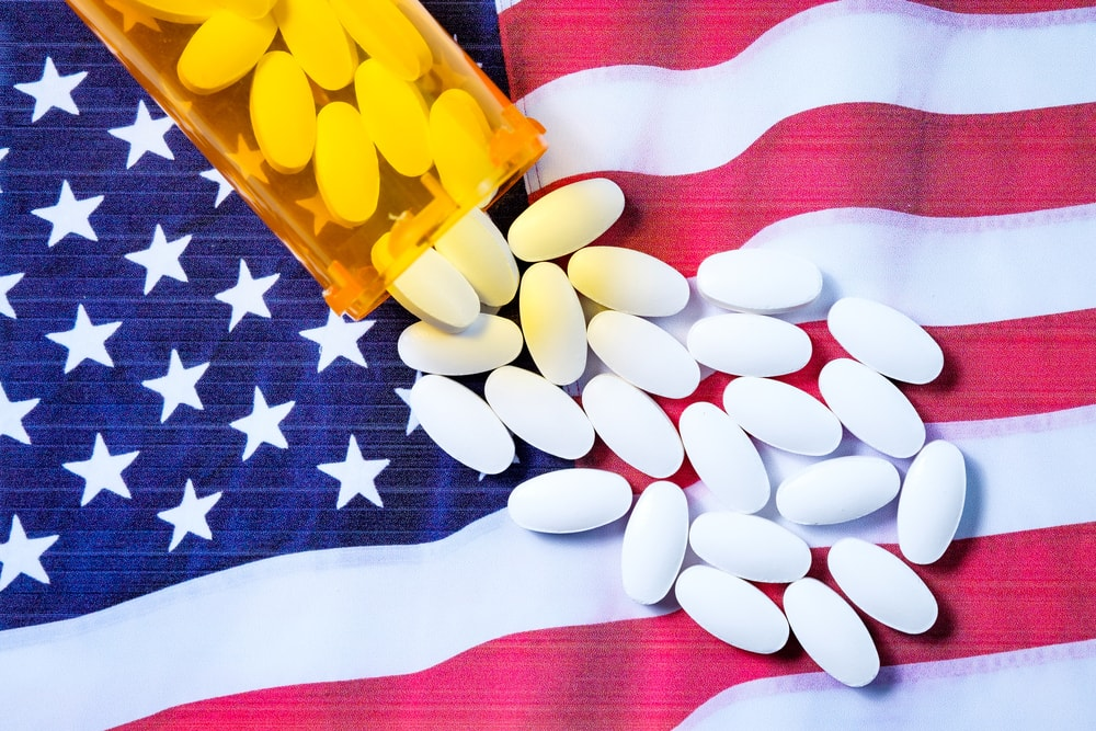 Opioid pills on American flag background