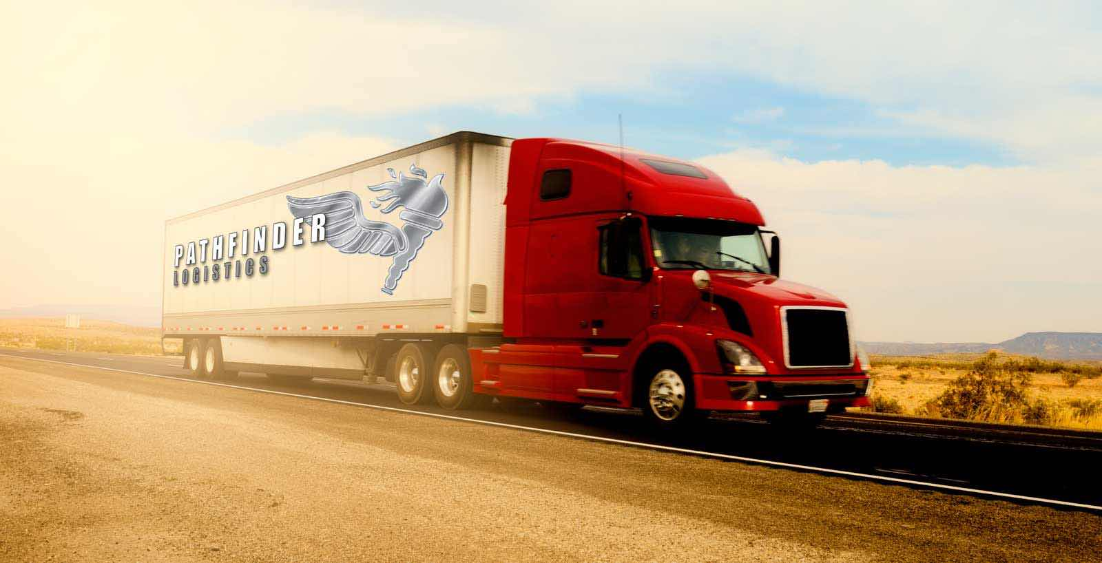 Photo of Pathfinder Logistics Truck Driving On Road