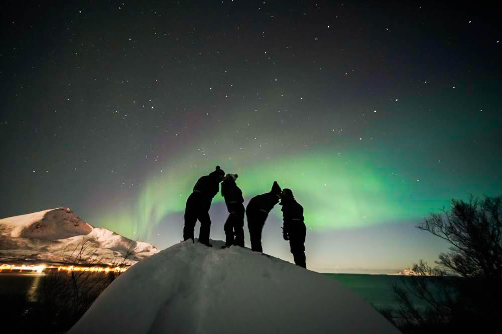Picture of northern lights over a mountain