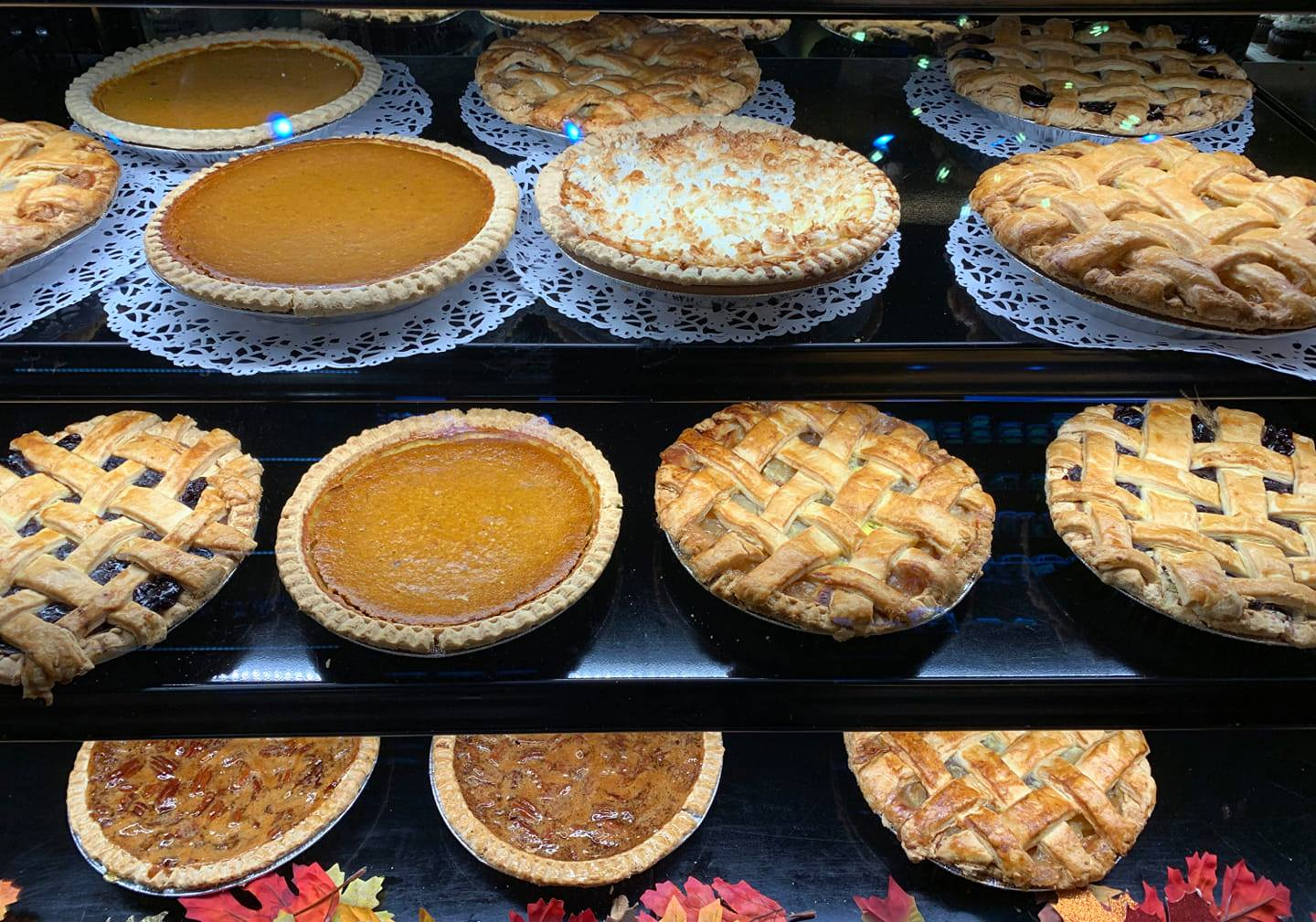 Shelf with variety of pies