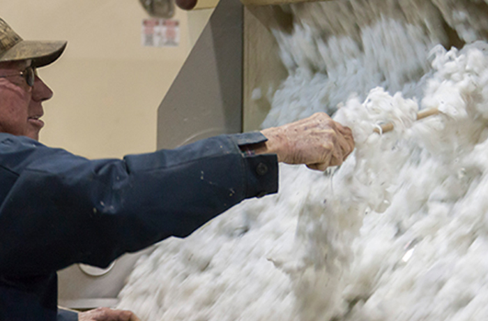 man working with cotton
