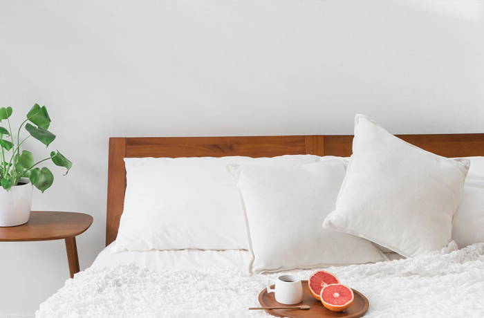 white cotton sheets on bed