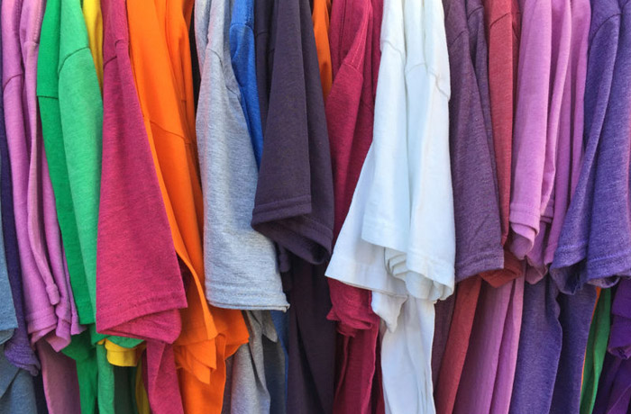 colored cotton t-shirts on hangers