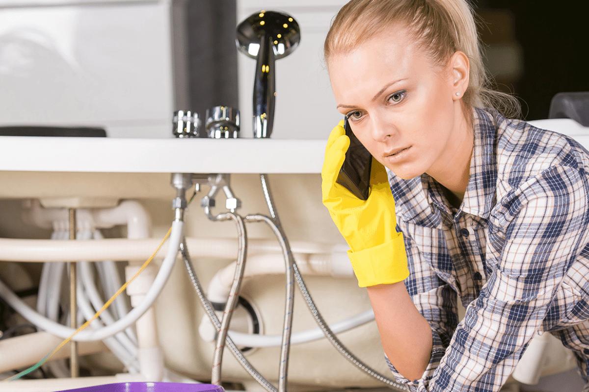 Woman calling plumber