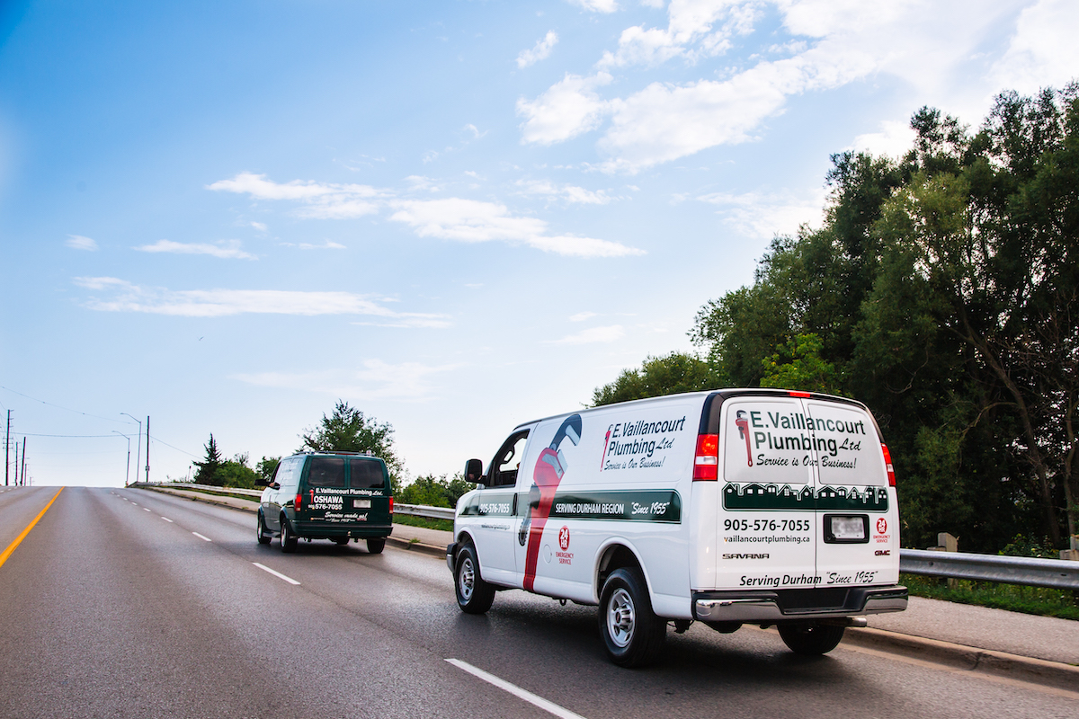 Vaillancourt Plumbing trucks driving down road