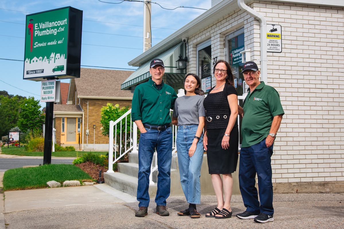 Vaillancourt Family outside of Vaillancourt Plumbing Office Building