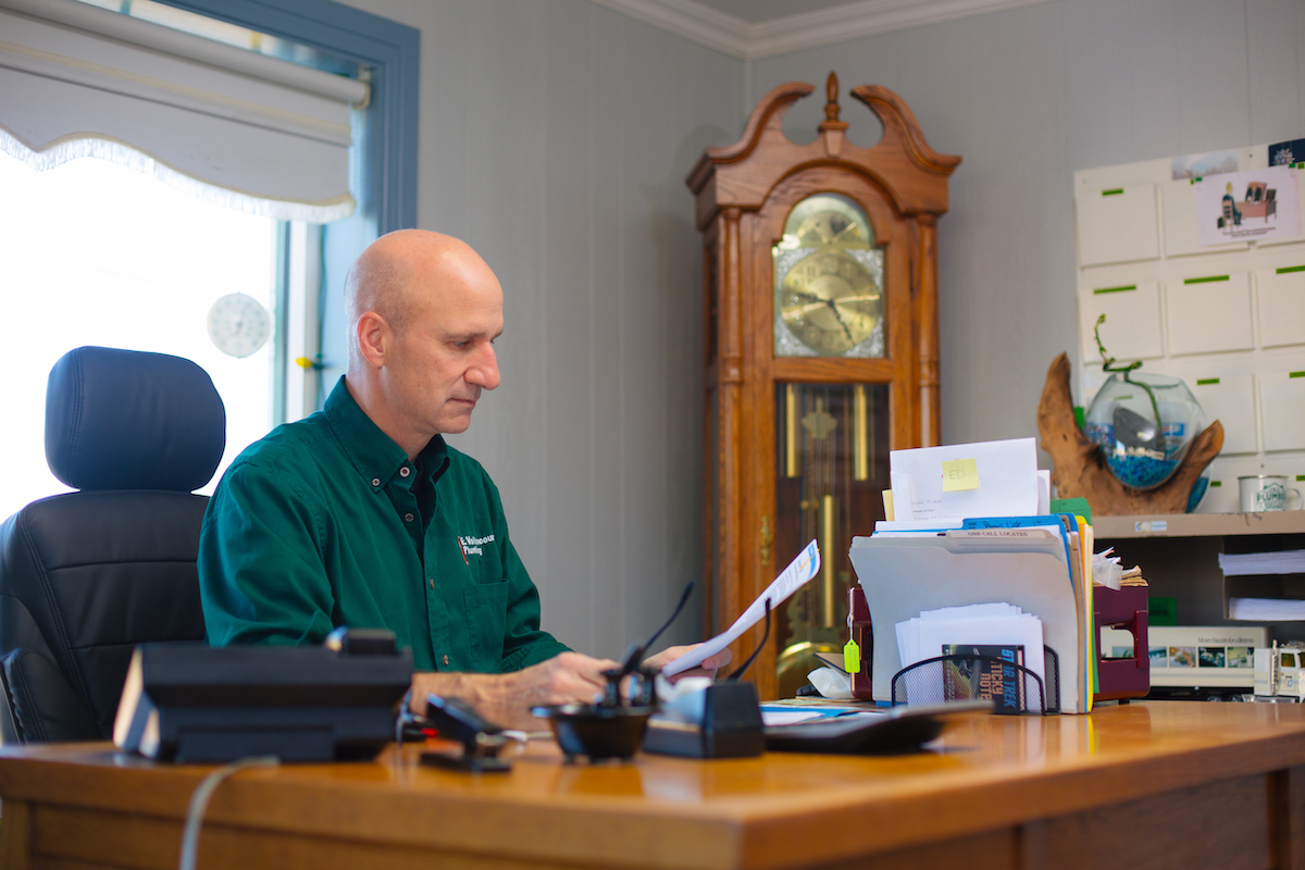 Brian Vaillancourt working at Vaillancourt Plumbing Office