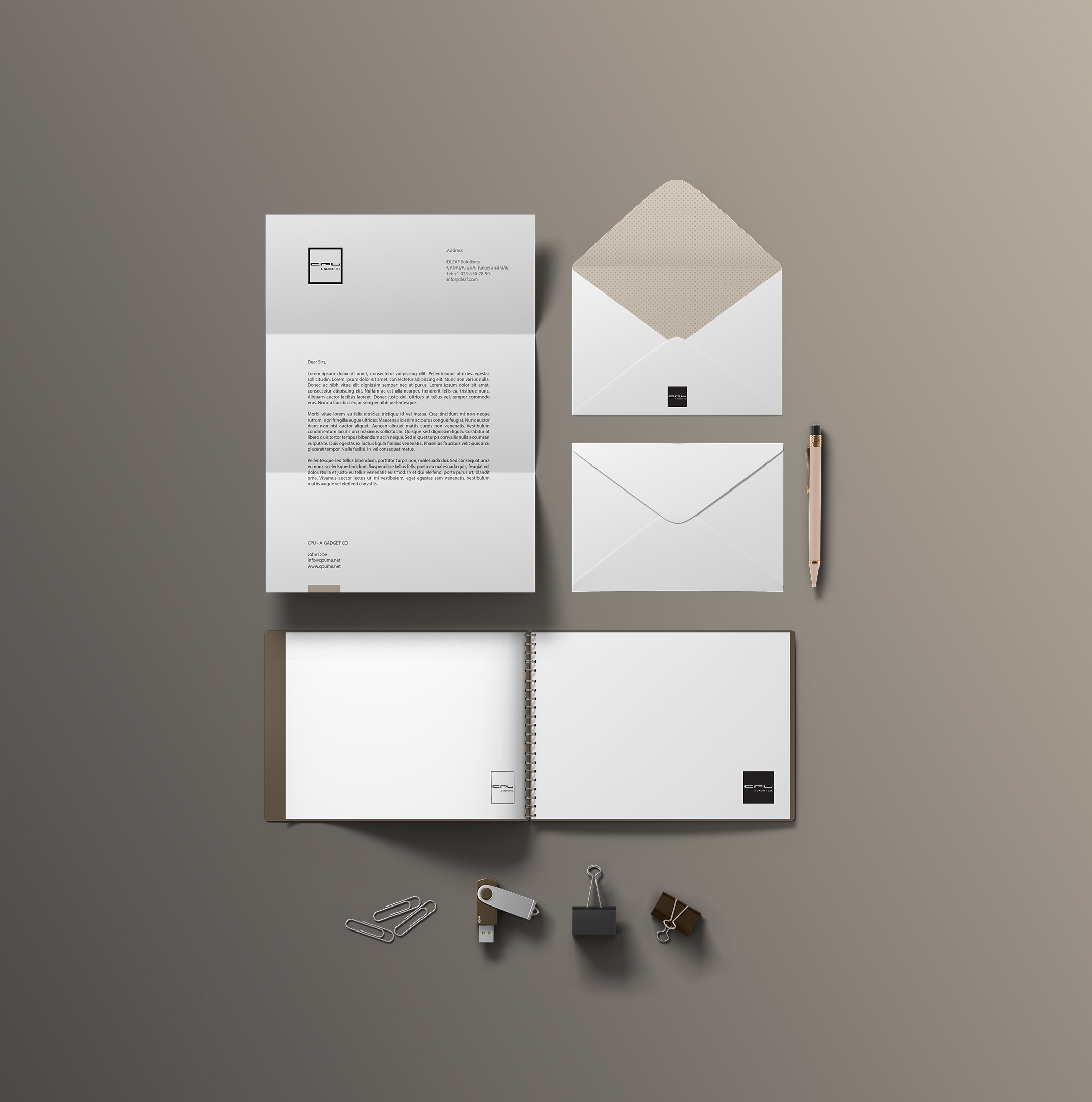 corporate identity letterhead, envelope, notebook and usb storage design