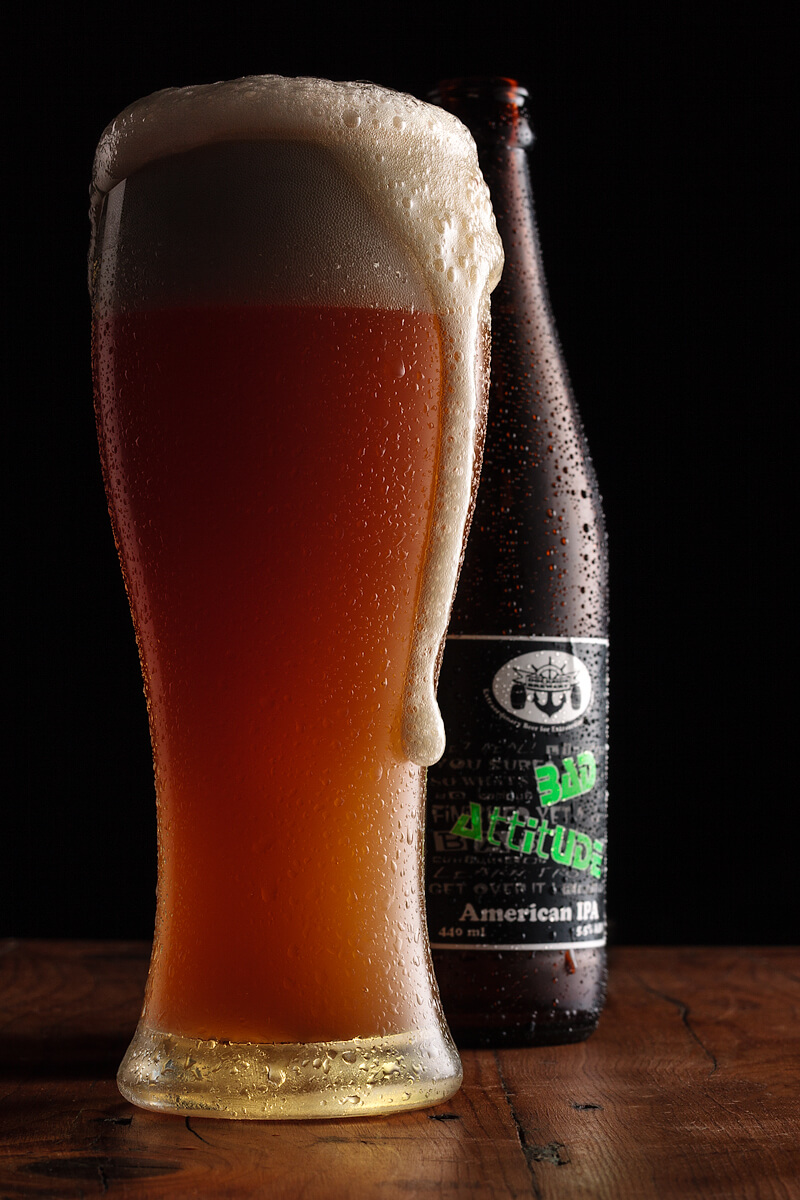 Advertorial style of product photography using light and shadow to show the character of the beer
