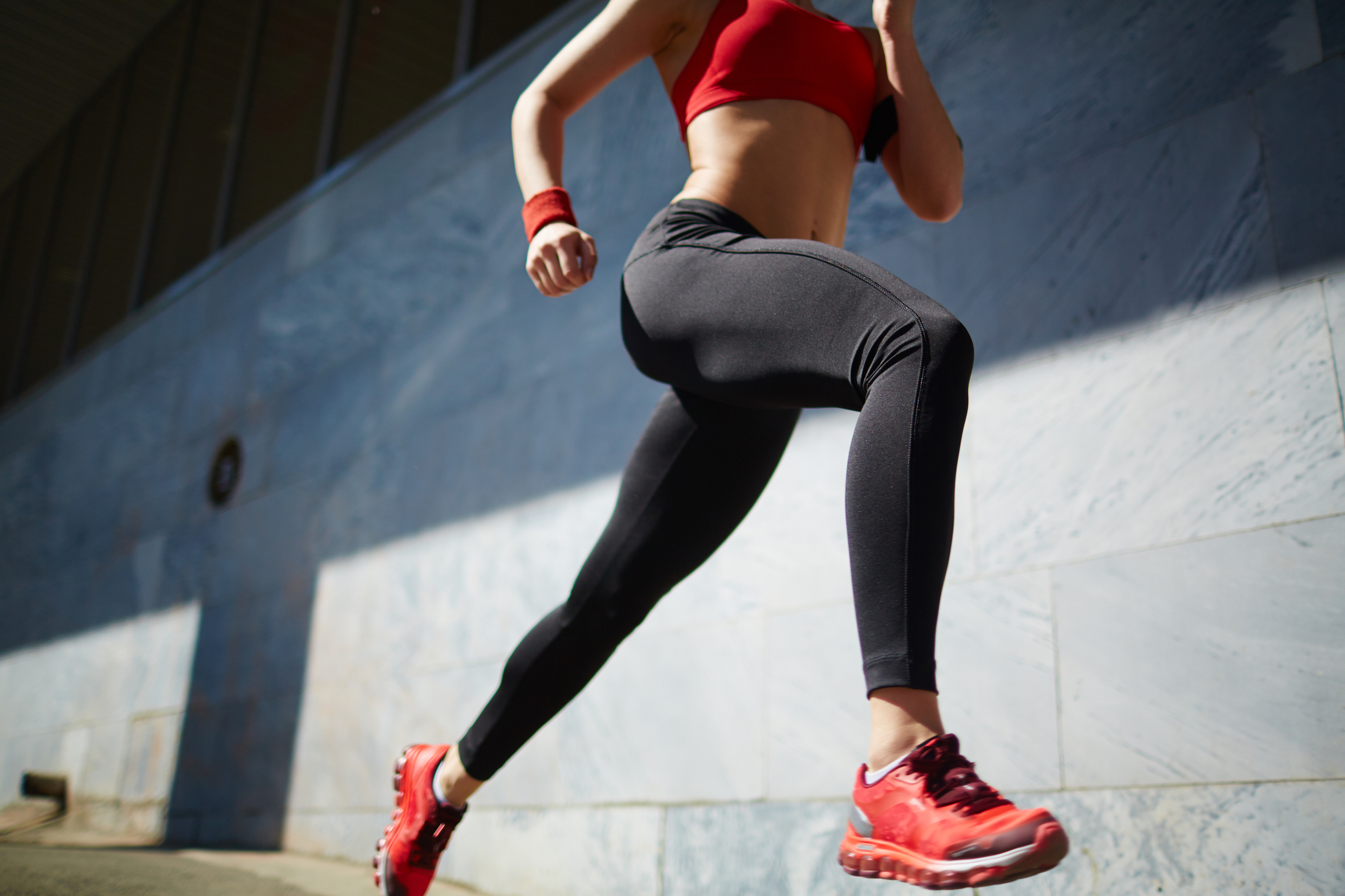 woman running HIIT exercise workout