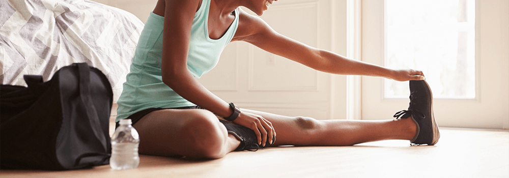 woman stretching before workout muscle recovery