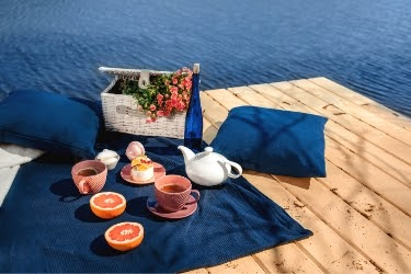 A romantic deck idea that you can try to set the mood is to use soft, luxurious linens.