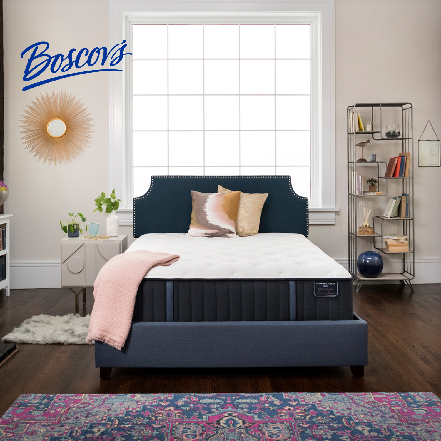 A bedroom with a new bed and white linen