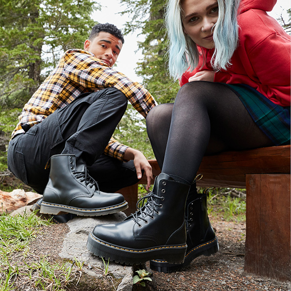 Photo of two teens wearing dr. martens boots