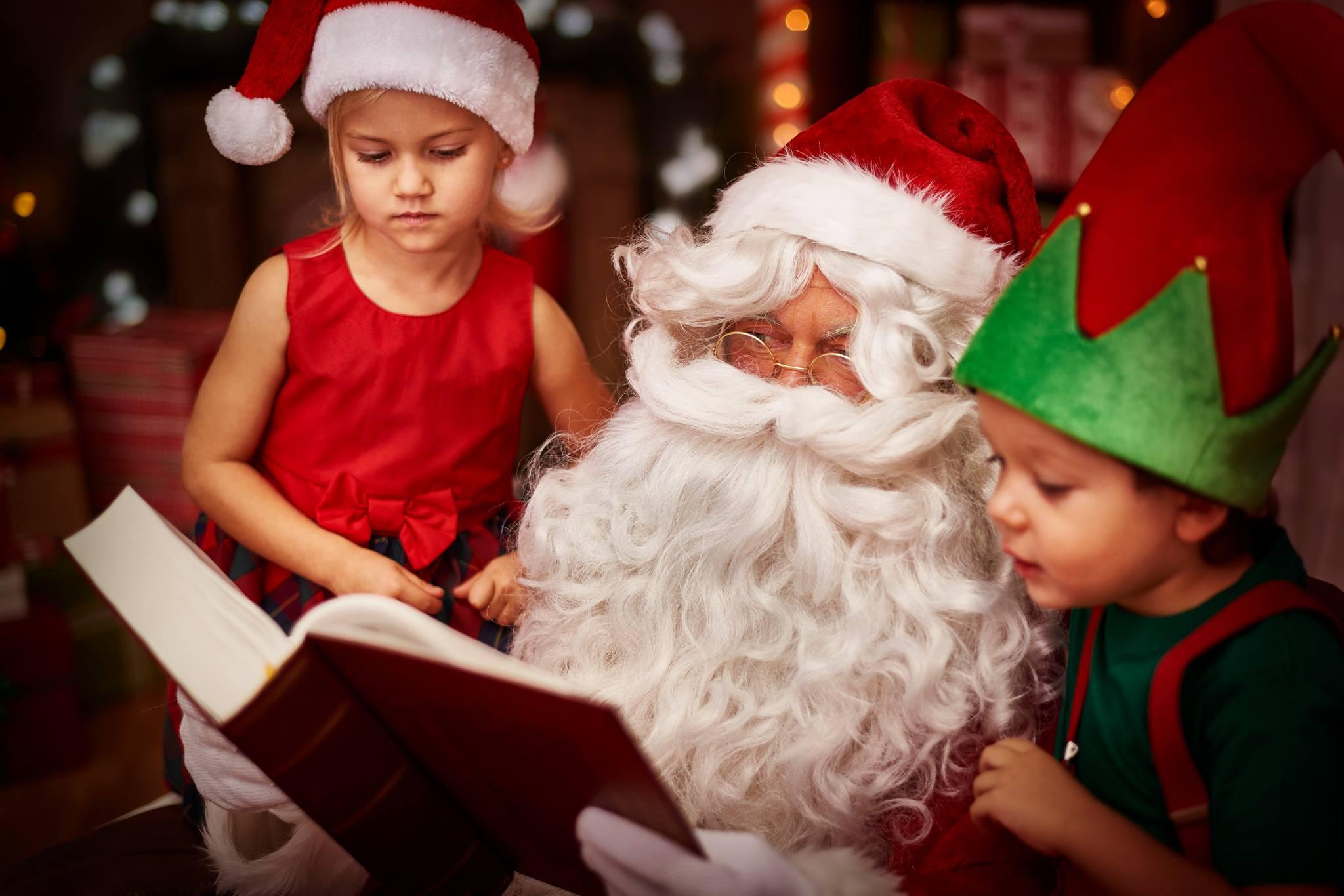 Photo of Santa reading to children