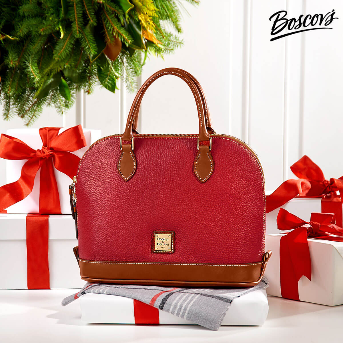 Photo of a red Dooney and Burke purse surrounded by presents