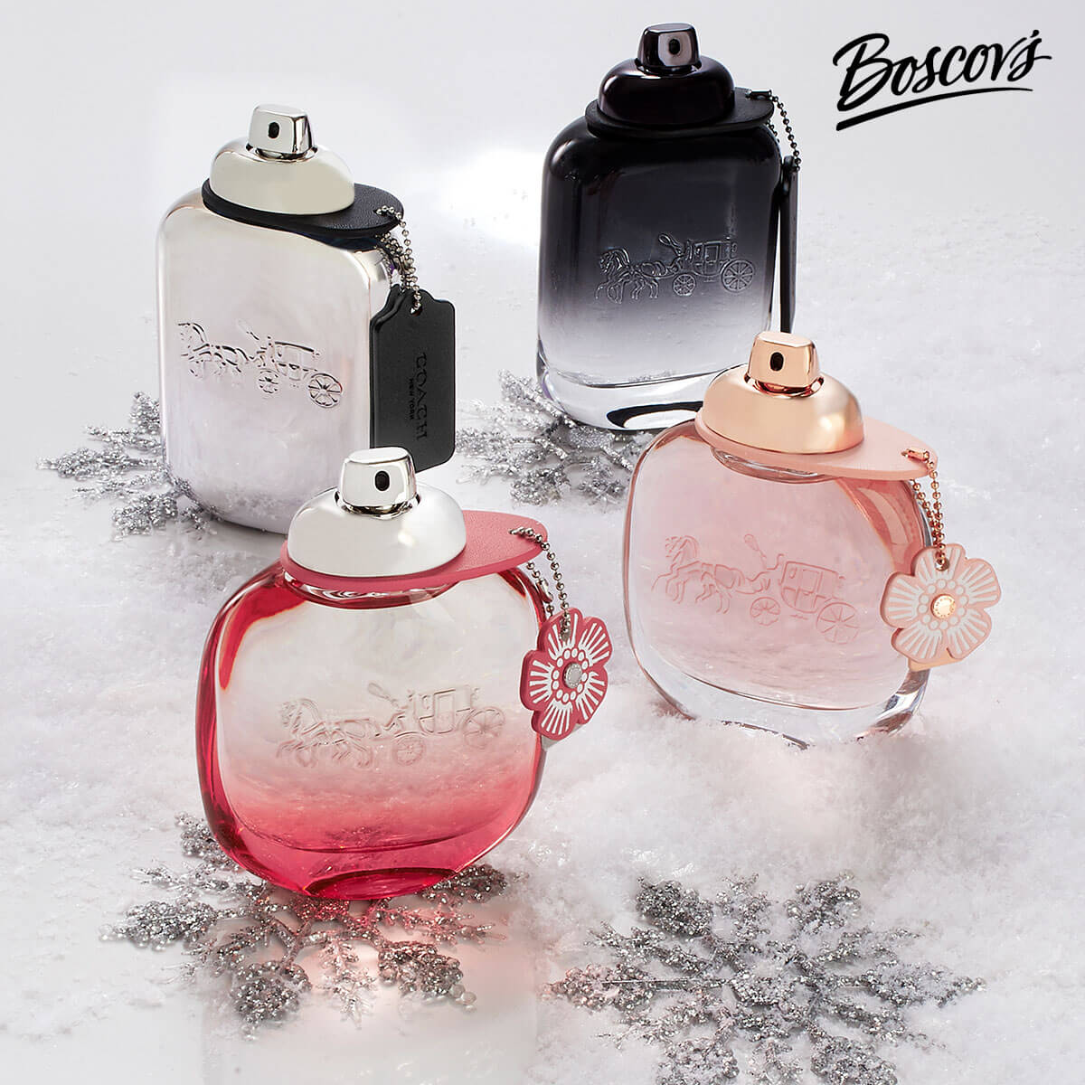 Photo of four different glass perfume bottles