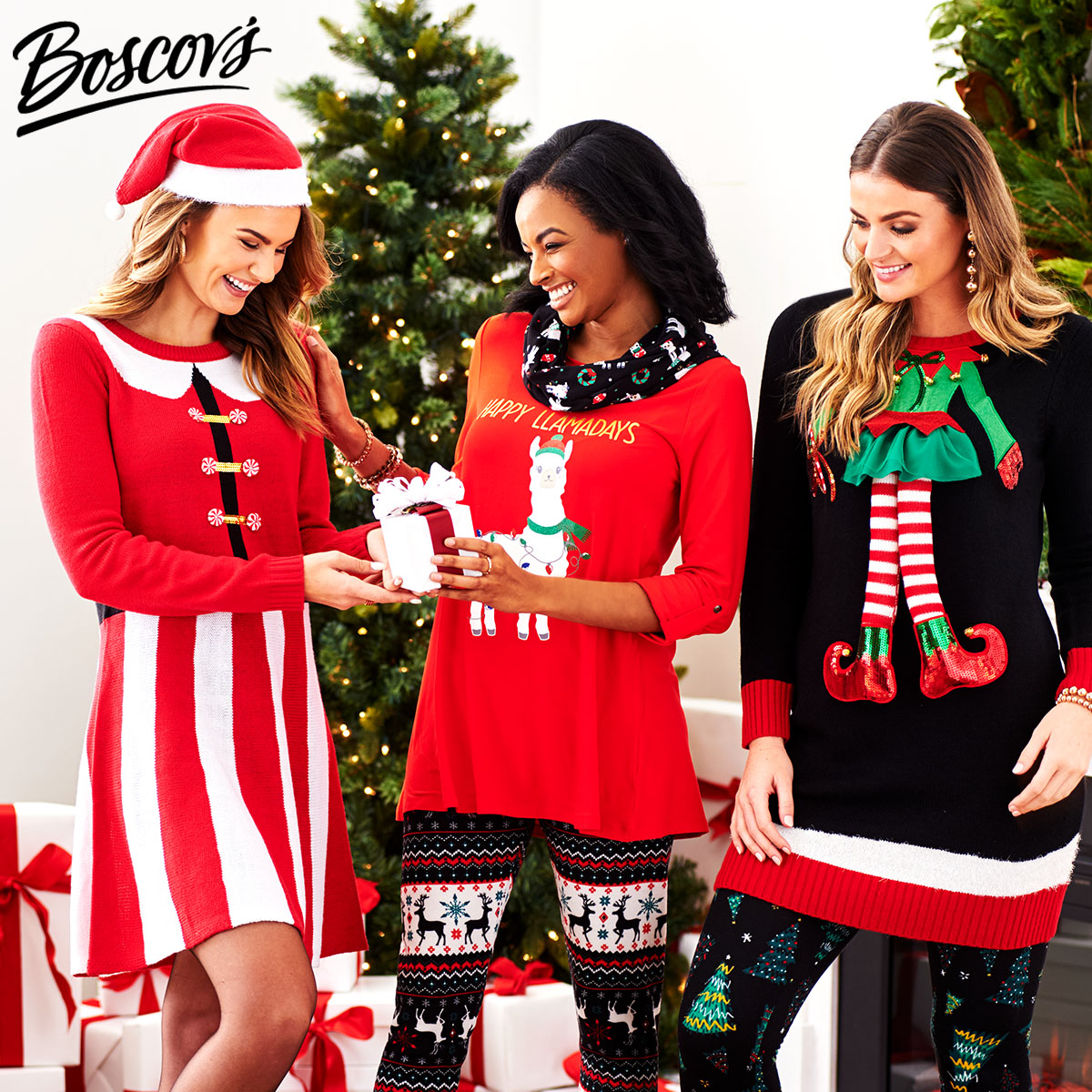 three women dressed in christmas attire exchanging gifts
