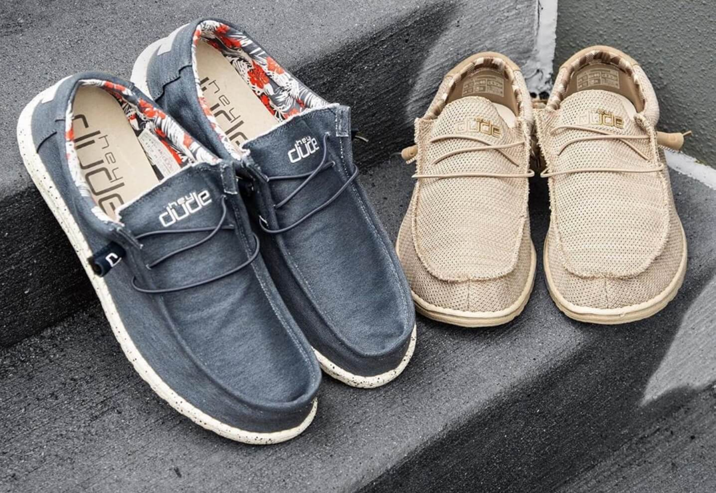 Photo of Hey Dude brand shoes in navy and tan