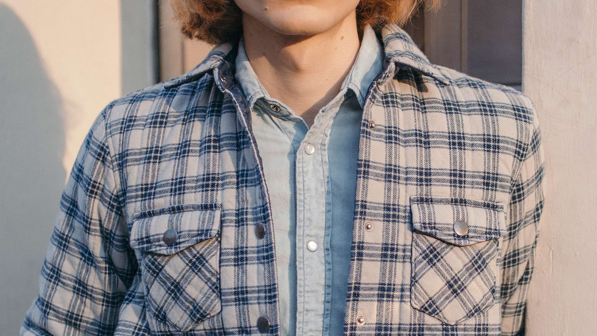 Closeup image of a blue and cream checkered jacket