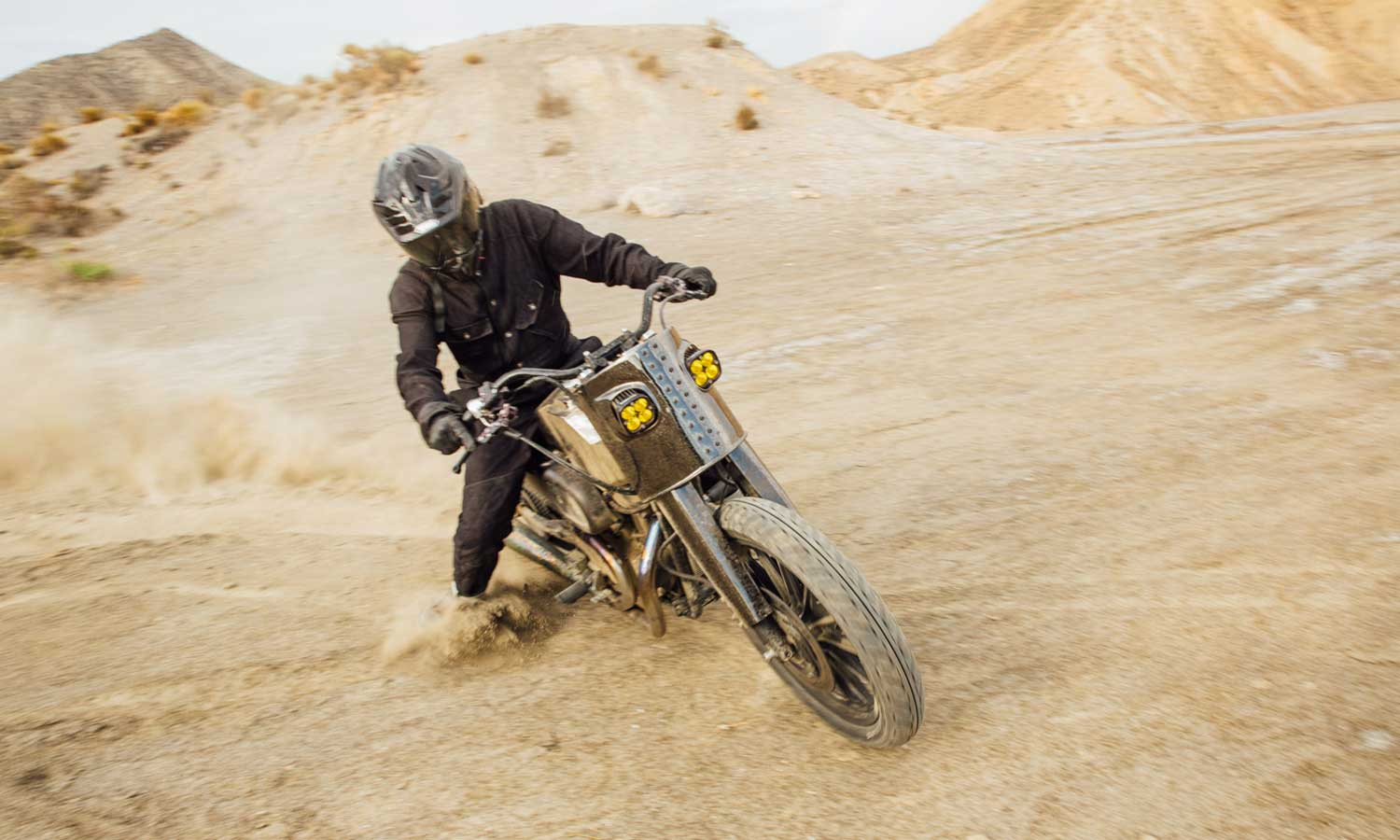 Motorcycle drifting in a desert