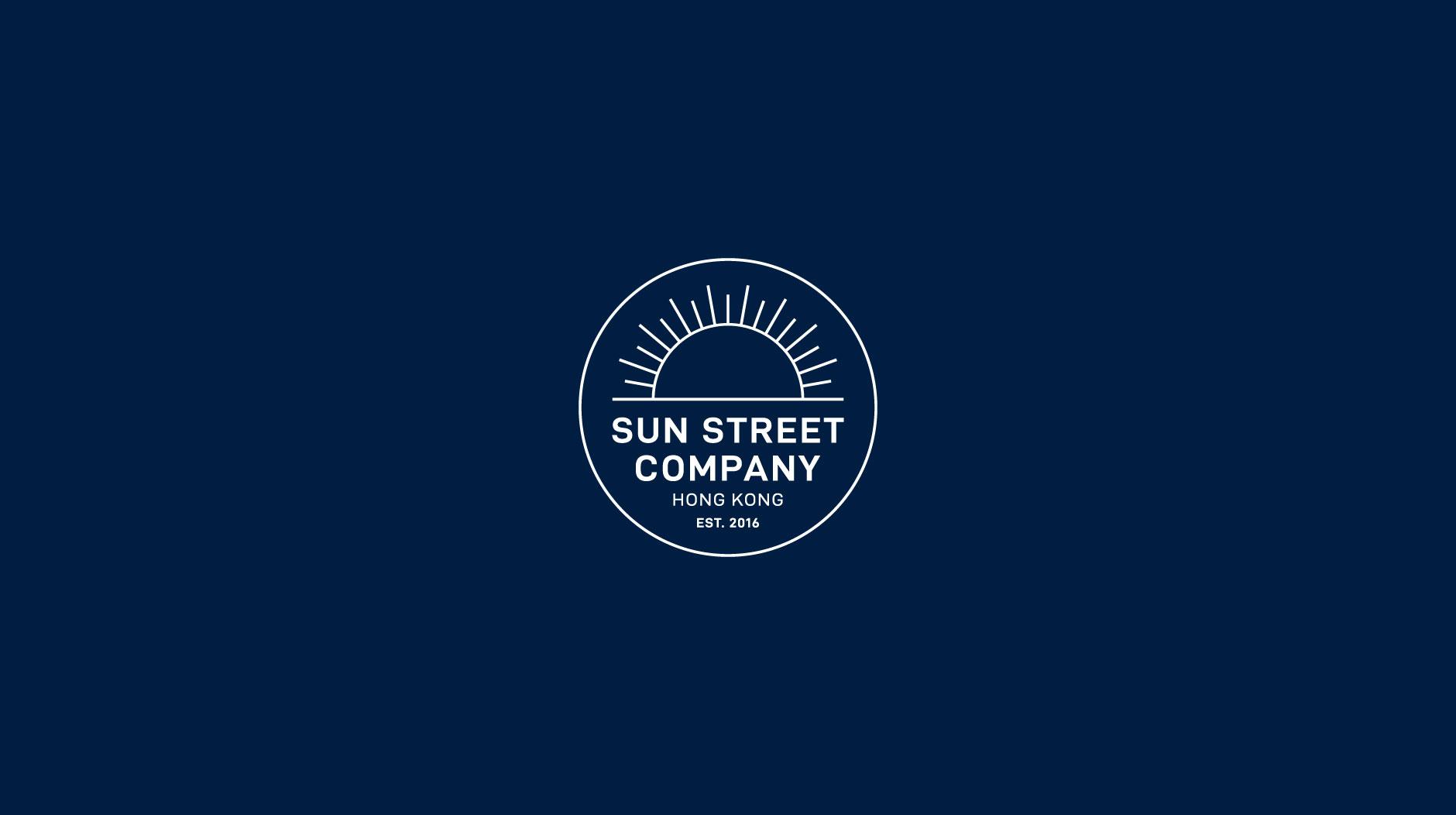 Sun Street white logo lockup on a dark blue background