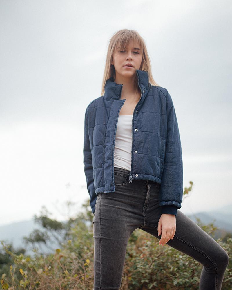 Girl wearing denim top and jeans posing