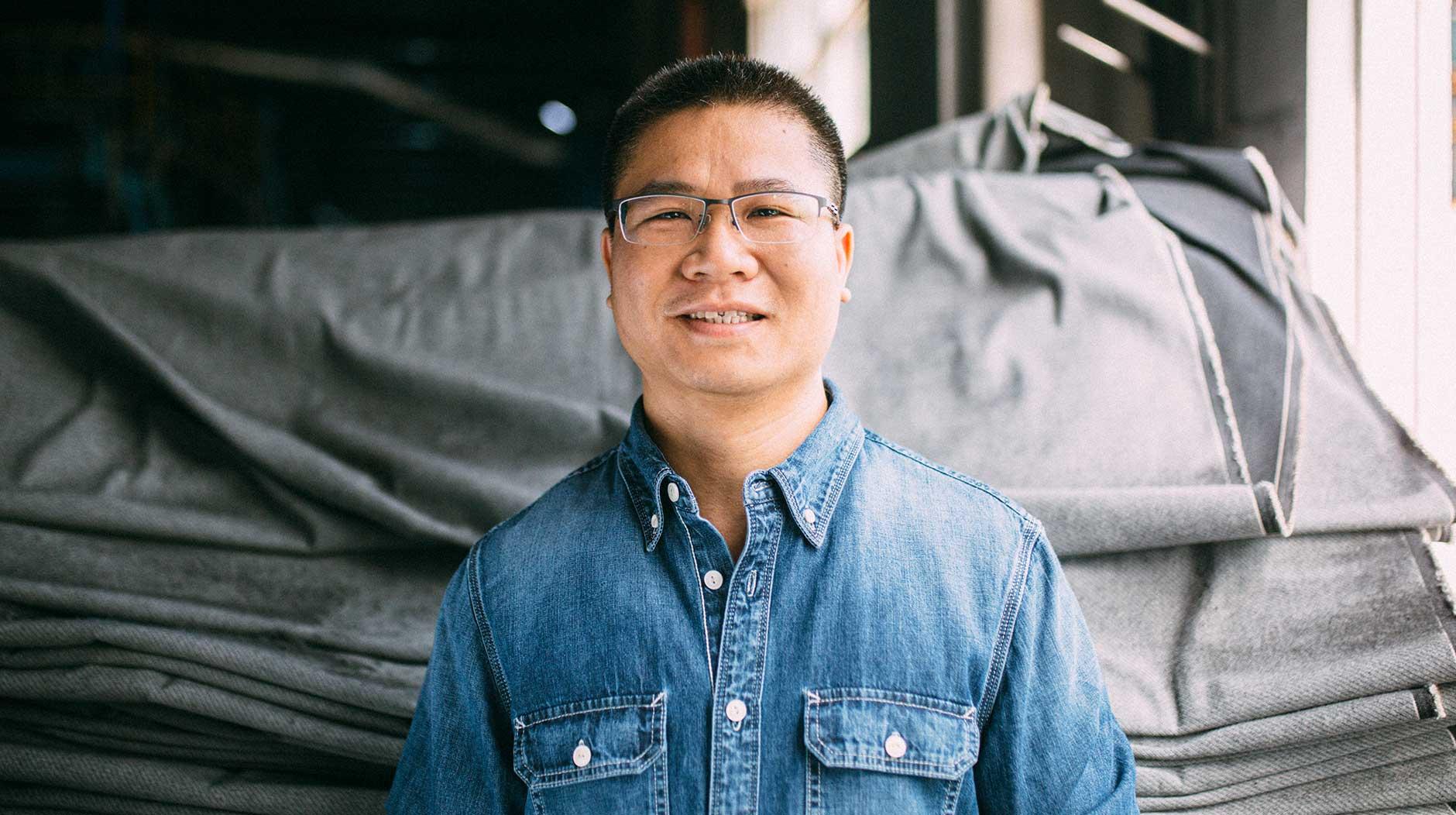 Guy smiling wearing denim shirt