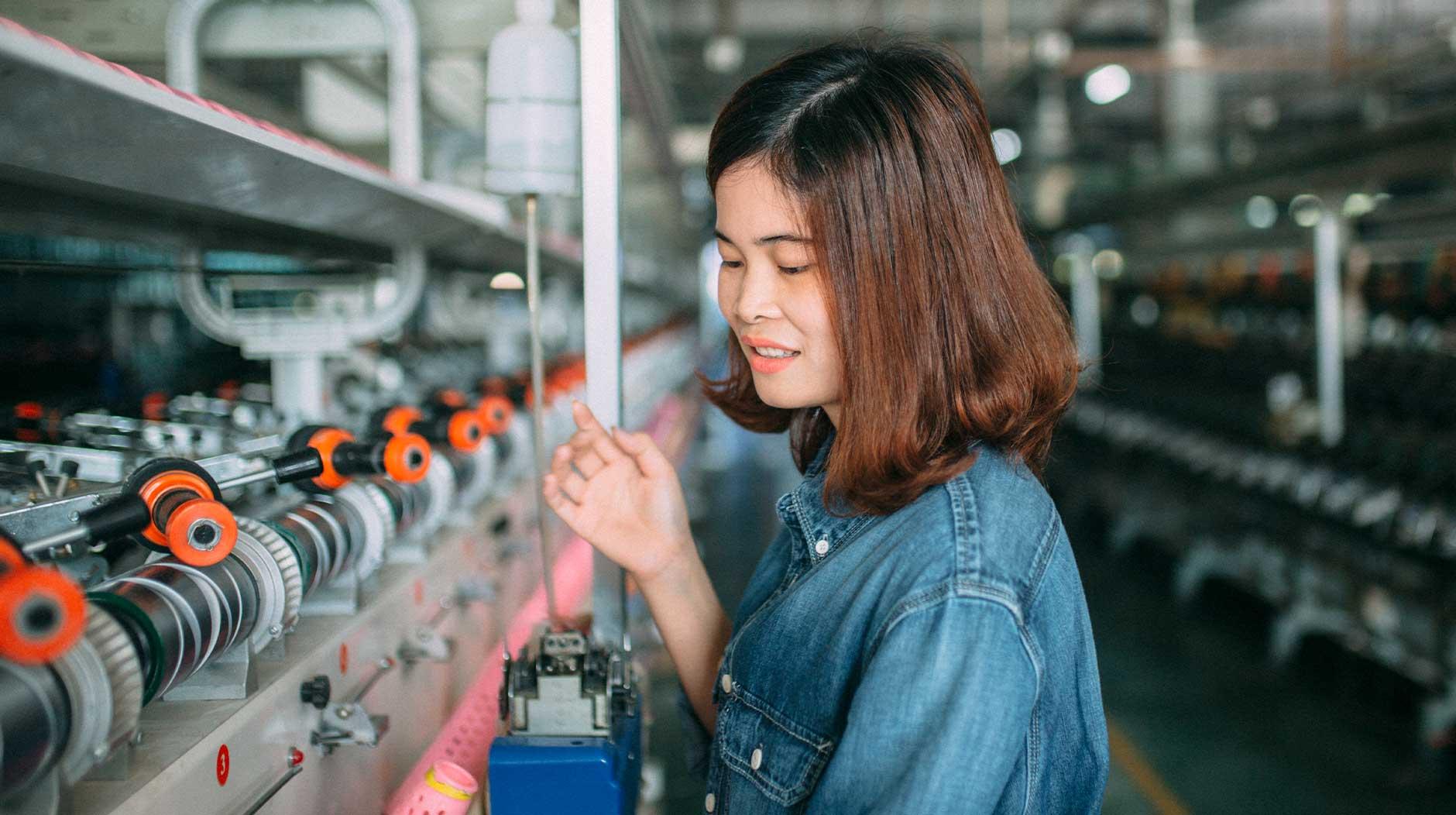 Girl working in a denim fabric manufacturer