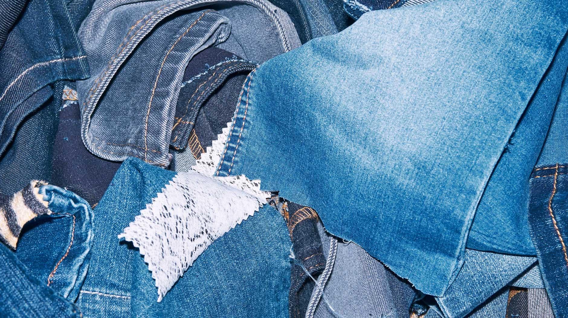 A pile of denim fabrics