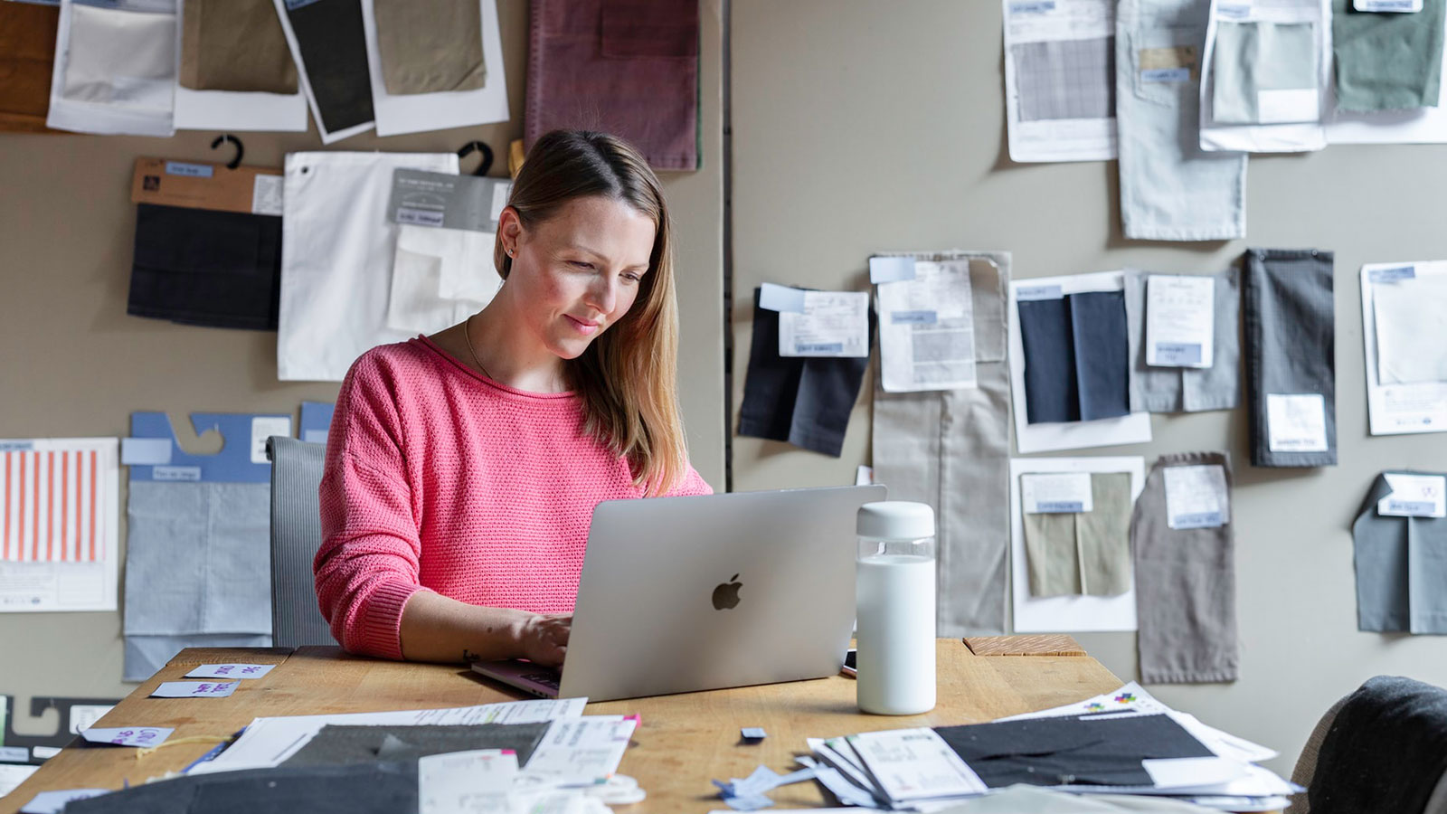 woman working with textiles using laptop banner image