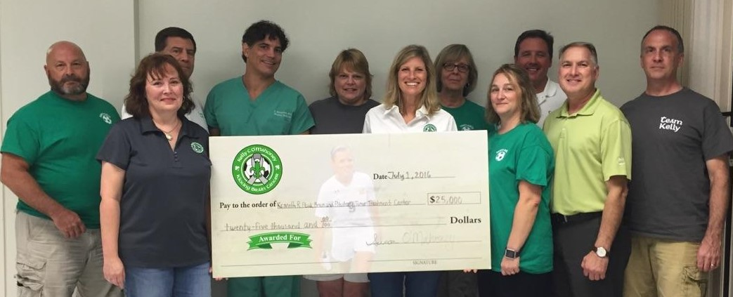 Kelly Kicking Cancer Research Committee Check Presentation