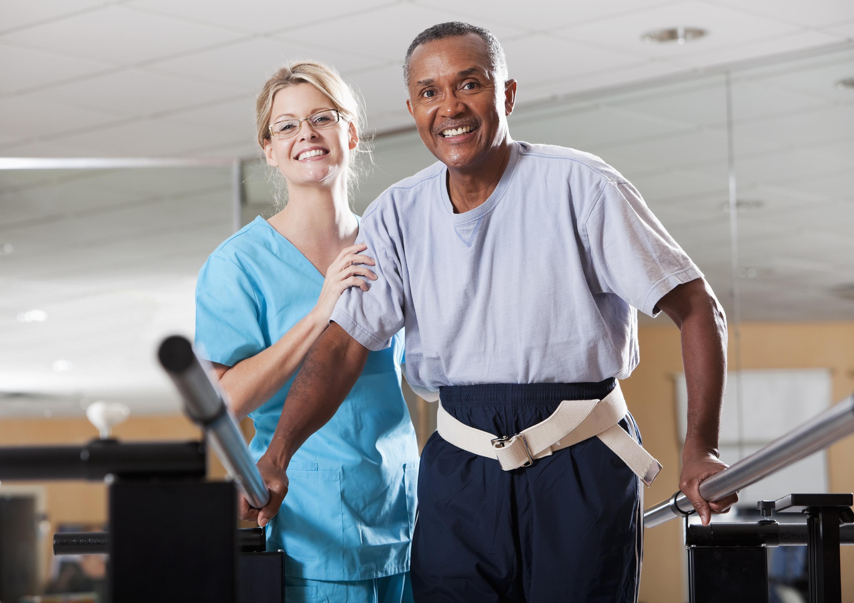 Photo of Man getting with nurse getting rehabilitation
