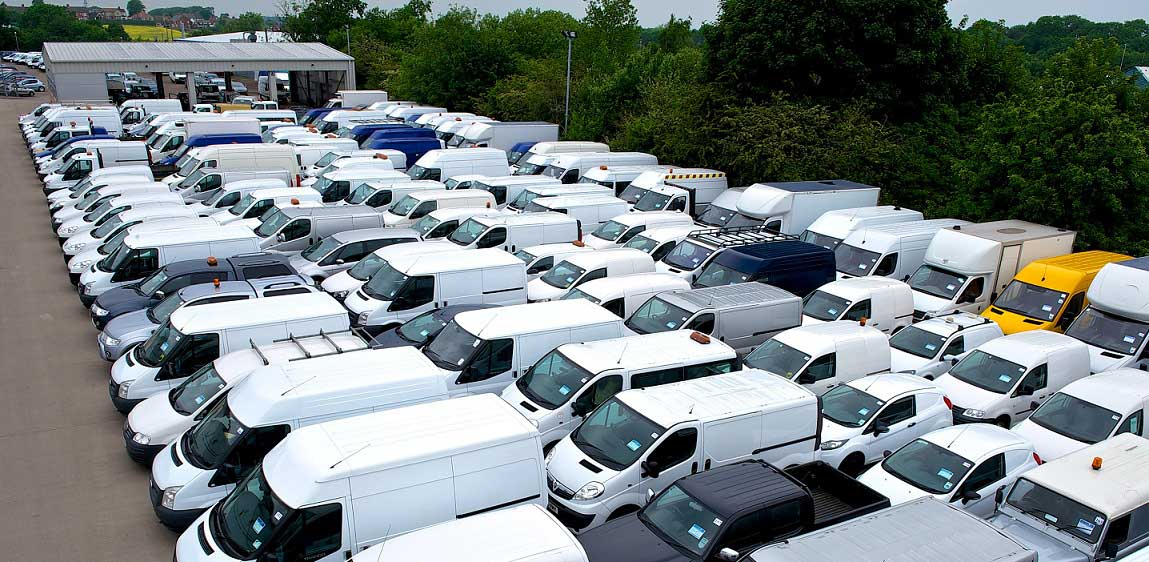 Cars parked in large storage park