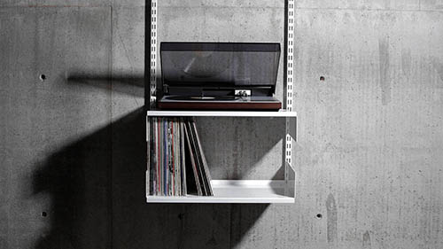 white shelf design for vinyl records and bang and olufsen record player
