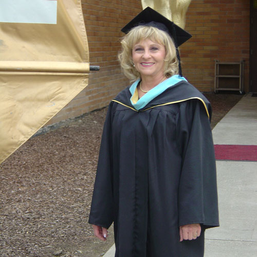 Woman posing in a cap and gown