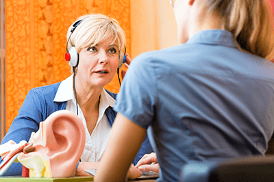Woman testing for hearing loss