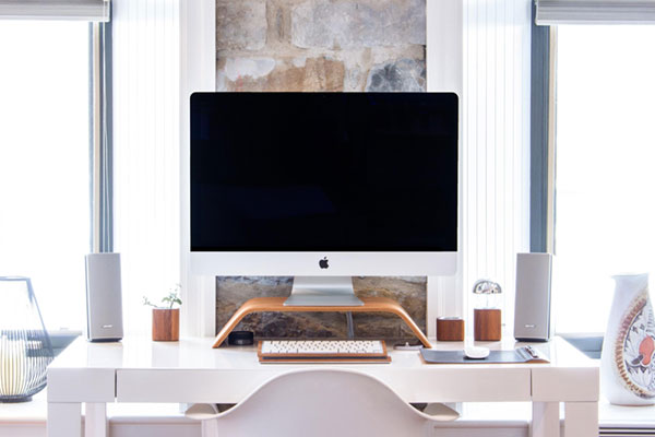 clean white desk with computer