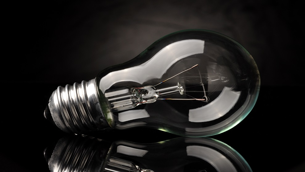 clear lightbulb with black background