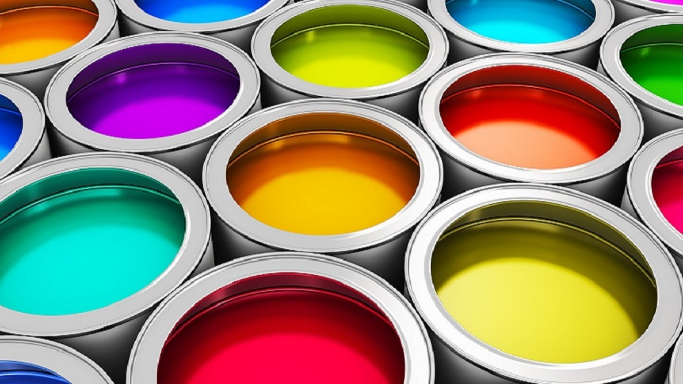 brightly colored paint in paint buckets
