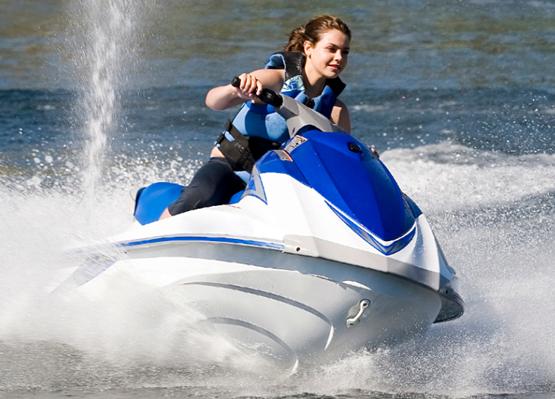 Girl riding a jet ski on lake